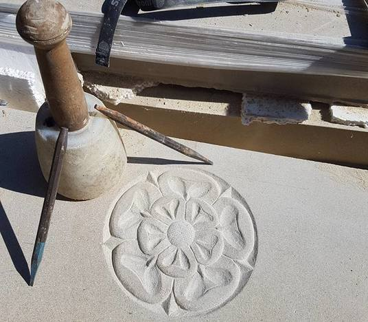 Hand carved Yorkshire Rose feature on one of our fireplaces
